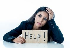 Young beautiful latin business woman overwhelmed and tired holding a help sign. looking Stressed, bored, frustrated, upset and royalty free stock images
