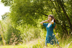 Young beautiful laughing girl on a meadow Royalty Free Stock Photo