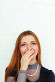 Young beautiful laughing woman looking up at copyspace Royalty Free Stock Image
