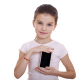 Young beautiful little girl shows a new smart phone Stock Photo