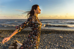 Young beautiful long hair woman on windy seashore Royalty Free Stock Photography