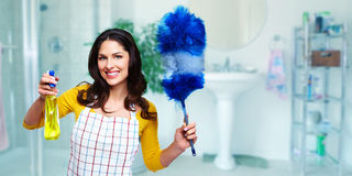 Young beautiful maid. Young smiling maid. House cleaning service concept royalty free stock images