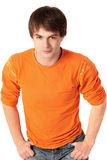 Young beautiful man. Portrait of young beautiful romantic man in a bright orange sweater isolated on white background Stock Image