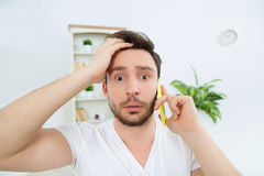 Young beautiful man amazed by very important information. Royalty Free Stock Images