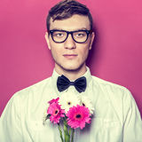 Young beautiful man with flowers Royalty Free Stock Image