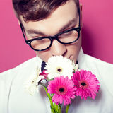 Young beautiful man with flowers Royalty Free Stock Photos