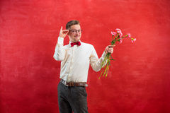 Young beautiful man with flowers Stock Images