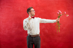 Young beautiful man with flowers Stock Image