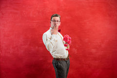 Young beautiful man with flowers Royalty Free Stock Photography