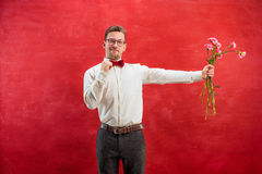 Young beautiful man with flowers Stock Photography