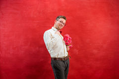 Young beautiful man with flowers Royalty Free Stock Images