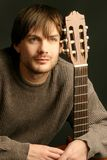 Young beautiful man with guitar. Portrait of young beautiful romantic man with his classical guitar Stock Image
