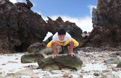 Young beautiful man meditation on beach.  Royalty Free Stock Photos