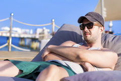 Young beautiful man relaxing and looking the blue sea Royalty Free Stock Photo