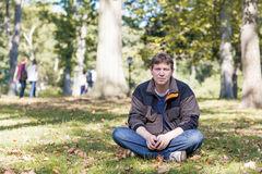 Young beautiful man in spring park Royalty Free Stock Photography