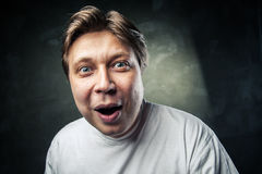 Young beautiful man surprised face expression Stock Photography