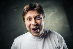 Young beautiful man surprised face expression Stock Image