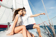 Young beautiful married couple embracing on the yacht Royalty Free Stock Images