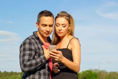 Two Young beautiful man and woman in casual clothes making selfi Stock Photo