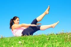 Young Beautiful Mixed Race Woman Doing Pilates Royalty Free Stock Photography