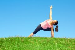 Young Beautiful Mixed Race Woman Doing Yoga Warrior Pose Stock Photography