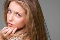 Young beautiful model. Posing on grey background, studio shot Royalty Free Stock Photos