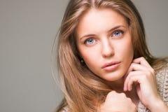 Young beautiful model. Posing on grey background, studio shot Royalty Free Stock Image
