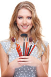 Young beautiful model with brushes Stock Images