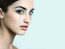 Young  beautiful model with golden tears. Stock Photo