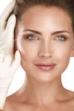 Young beautiful model injecting  a cosmetic treatment Stock Photos