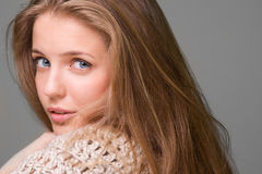 Young beautiful model looking over the shoulder Royalty Free Stock Images