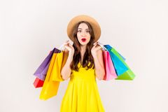 Young beautiful model with lots of shopping bags in hands stock images