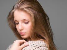 Young beautiful model posing, studio shot. Young beautiful model posing on grey background, studio shot Stock Photo