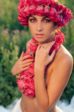Young beautiful model with rose crown. Outdoors Stock Images