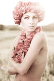 Young beautiful model with rose crown royalty free stock photo
