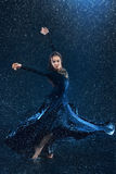 The young beautiful modern dancer dancing under water drops Stock Photography