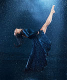 The young beautiful modern dancer dancing under water drops Royalty Free Stock Photo