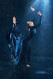 The young beautiful modern dancer dancing under water drops Stock Image