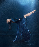 The young beautiful modern dancer dancing under water drops Royalty Free Stock Photography