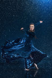 The young beautiful modern dancer dancing under water drops Royalty Free Stock Images