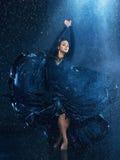 The young beautiful modern dancer dancing under water drops Stock Photos