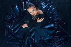 The young beautiful modern dancer posing under water drops Stock Images