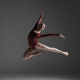 Young beautiful modern style dancer jumping on a Stock Images
