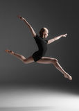 Young beautiful modern style dancer jumping on a Stock Photos