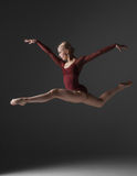 Young beautiful modern style dancer jumping on a Royalty Free Stock Photo