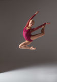 Young beautiful modern style dancer jumping on a Stock Image