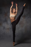 Young beautiful modern style dancer posing on a. The young beautiful modern style dancer posing on a studio gray background stock photos