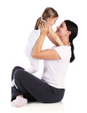 Young Beautiful Mom Holding Small Daughter. Royalty Free Stock Photography