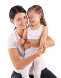 Young beautiful mom holding small daughter. Royalty Free Stock Photos