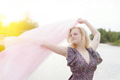 Young beautiful moody blonde female waving silk Royalty Free Stock Photography
